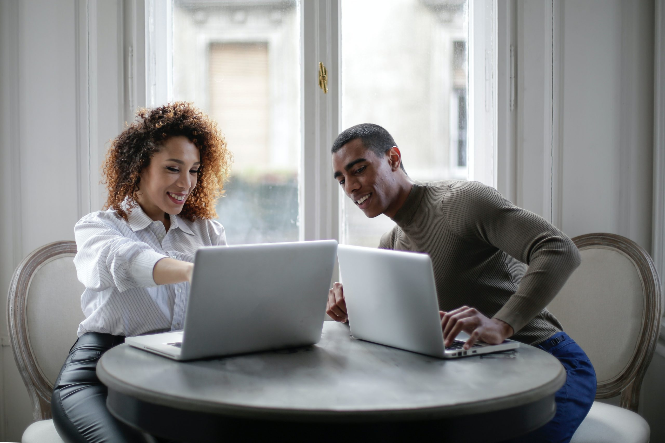 Couple with laptops